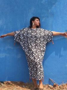 A woman wearing a black and white heart print cotton kaftan